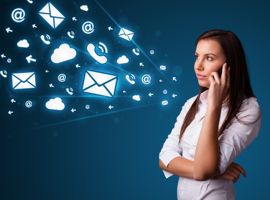 Young lady standing and making phone call with message icons