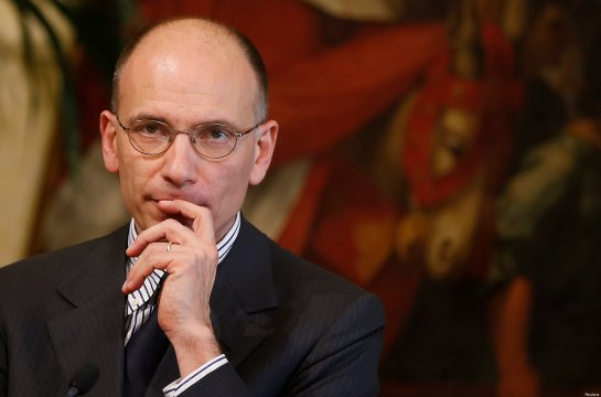 Italy's Prime Minister Letta listens to a reporter's questions during a joint news conference with Gurria, secretary-general of the Organisation for Economic Co-operation and Development (OECD)  at Chigi Palace in Rome